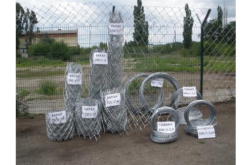 Ограждение участков из быстровозводимых конструкций из колючих заграждений., фото — «Реклама Севастополя»