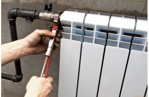 Сантехник. Монтаж системы отопления, установка радиаторов, фото — «Реклама Севастополя»
