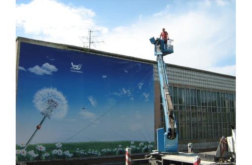 Монтаж и демонтаж рекламы в Севастополе, фото — «Реклама Севастополя»