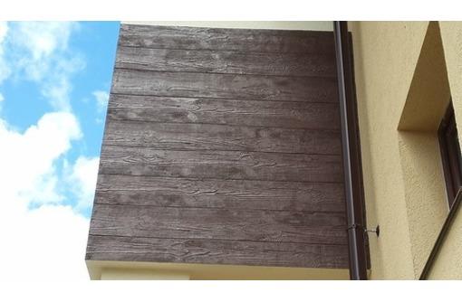 Отделка стен и фасадов  с имитацией дерева, фото — «Реклама Севастополя»