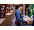 Thumb_big_porter-carrying-boxes-in-a-warehouse