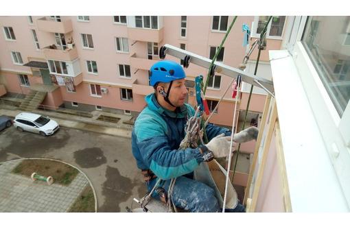 Высотные работы Севастополь. Утепление квартир,  частных домов, пристроек, гаражей., фото — «Реклама Севастополя»