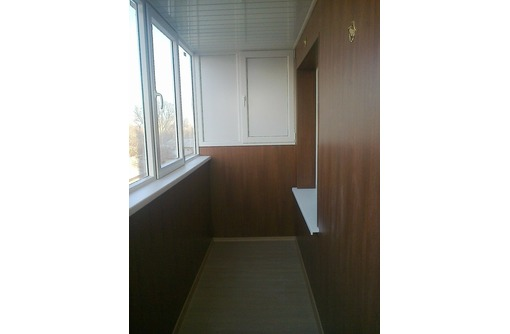 отделка балконов ламинатом, фото — «Реклама Краснодара»