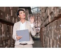 Thumb_big_warehouse%20manager%20checking%20her%20inventory%20in%20a%20large%20warehouse