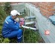Бурение вентиляционных отверстий в заборе для продувки двора, фото — «Реклама Краснодара»