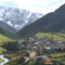 Micro_svaneti_old_village_in_georgia_medieval_tower_built_for_defensive_purposes_each_family_had_its_own_tower_in_the_background_is_seen_the_caucasian_mountains_and_clouds_r8gyu9u3xx_thumbnail_full01
