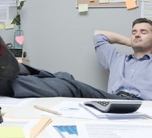 Mini_bigstock-lazy-office-worker-feet-up-75401689-1024x682_5be41695b426c