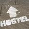 Mini_depositphotos_11321663-hostel-sign-on-the-grou